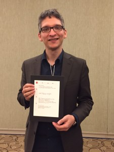 Timothy Lanzendörder, University of Mainz, with his prize certificate.